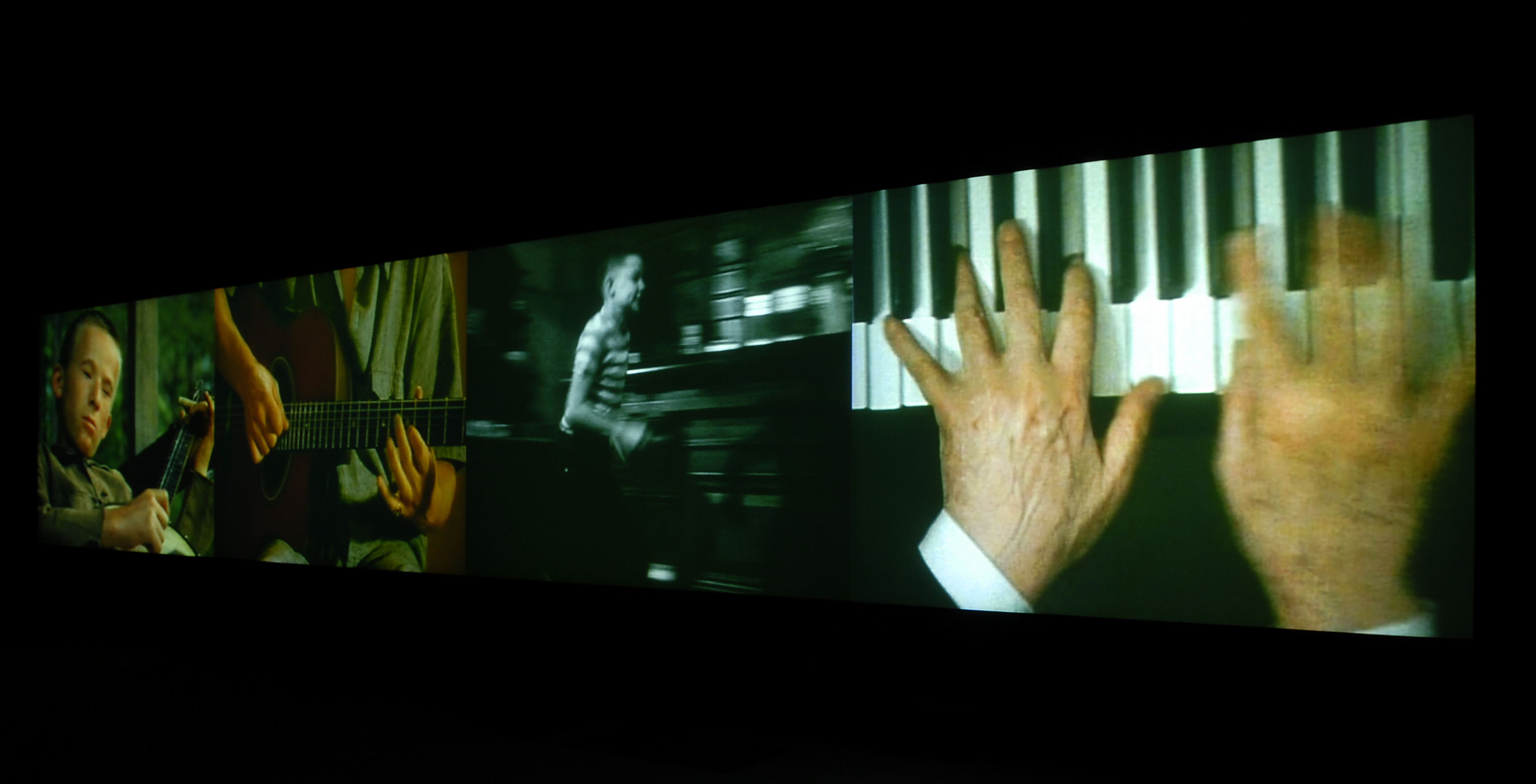Christian Marclay, *Video Quartet*, 2002, four-channel video projection, with sound, running time: 14 minutes; each screen: 8 x 10 feet; overall installation: 8 x 40 feet. © Christian Marclay. Courtesy Paula Cooper Gallery, New York and Tate, London.